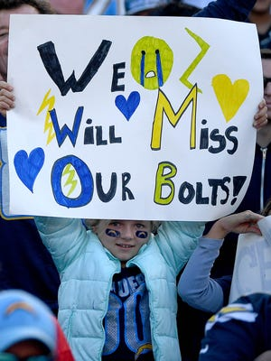 A fan of the San Diego Chargers holds a sign en route to the Charger's 37-27 loss to the Kansas City Chiefs during their NFL game at Qualcomm Stadium on January 1, 2017.