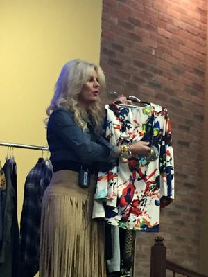 Wardrobe consultant Keri Galey shows off a blouse option and what accessories pair well with it at Daring Divas, an event presented by the Spirit of Women at Forrest General Hospital.