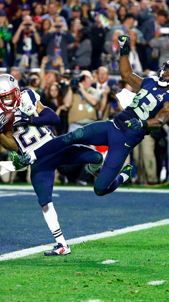Patriots strong safety Malcolm Butler intercepts a pass intended for Seahawks wide receiver Ricardo Lockette in the fourth quarter during Super Bowl XLIX.
