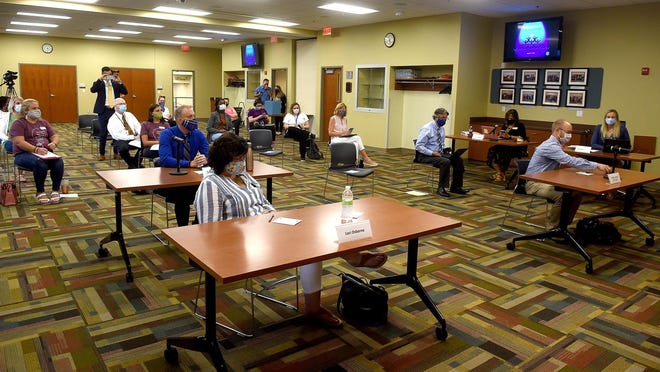 Less than 40 people were allowed inside the Columbia Board of Education's special meeting Monday that decided classes will begin online when classes begin Sept. 8.