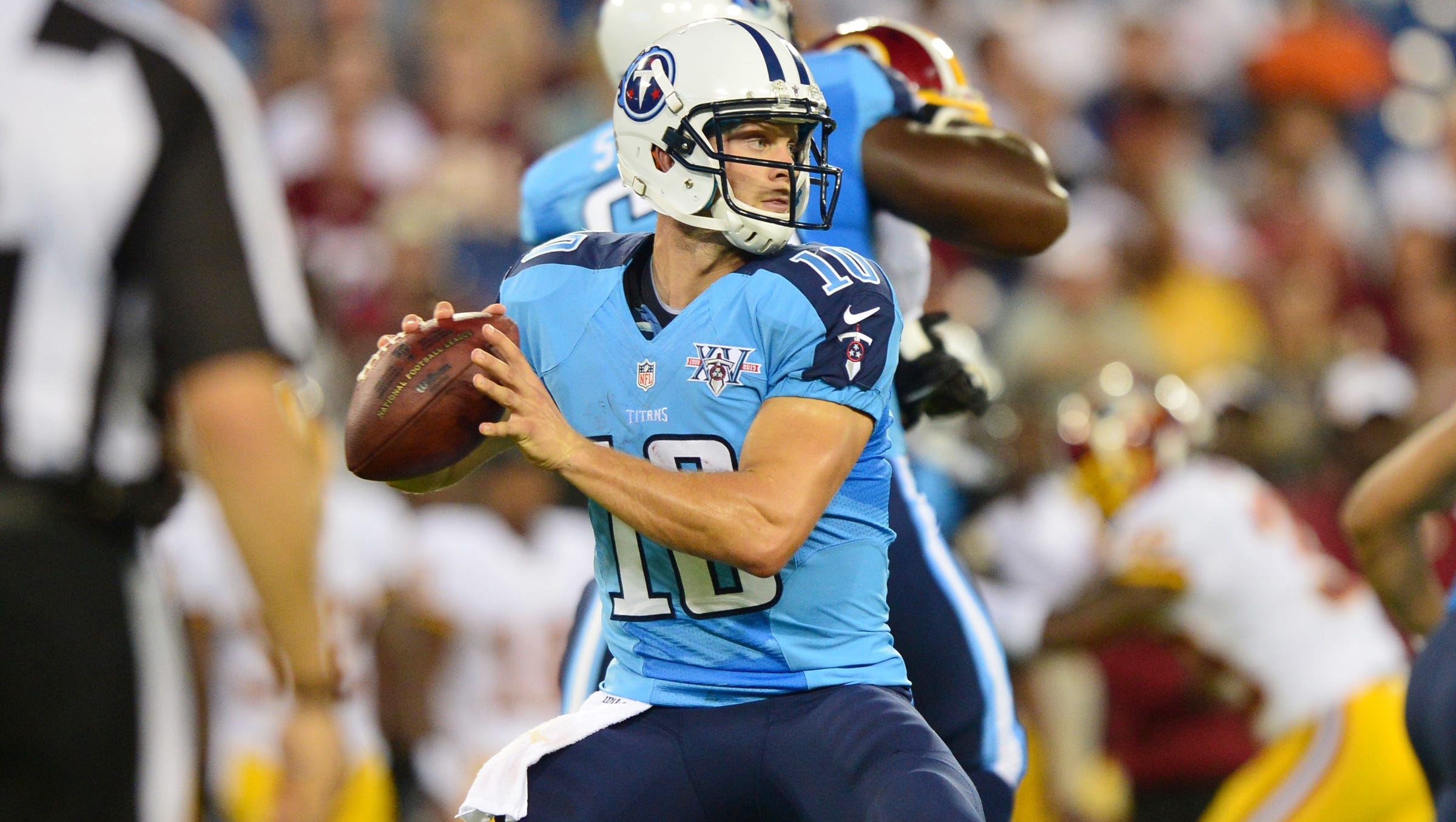 Tennessee Titans quarterback Jake Locker (10) passes against the Washington Redskins during the first half at LP Field.