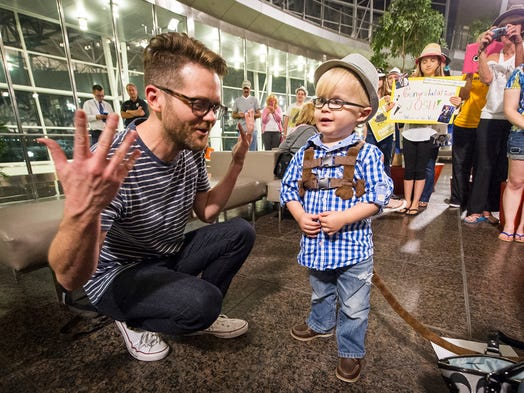 "Josh Kaufman chats with two-year-old fan Eli Humphrey, of Mooresville, during the airport reception. ""Why do you wear glasses,"" Eli asked. ""Just so I can see a little better,"" Kaufman quickly replied. Kaufman arrived back in Indianapolis Thursday, May 22, 2014, to a crowd of fans at Indianapolis International Airport. Kaufman, of Team Usher, captured the Season 6 crown on Tuesday night's episode of ""The Voice."""