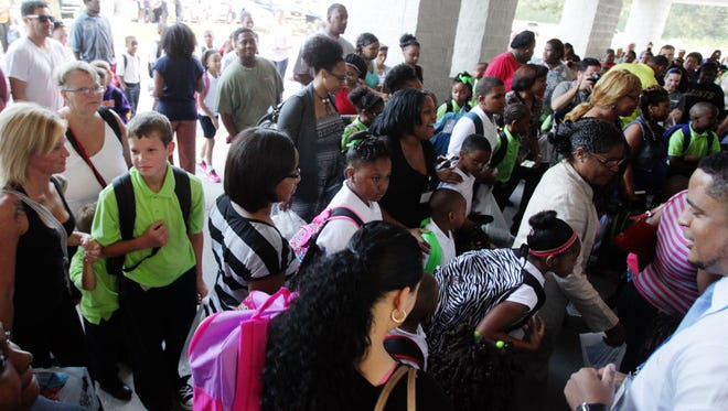 Parents drop off their children for the first day of school at Willow Charter Academy in August 2014.