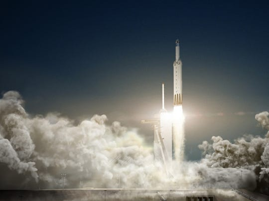 Concept image of a SpaceX Falcon Heavy rocket and Dragon spacecraft launching from Kennedy Space Center.