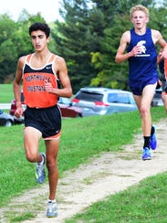 Northville runner Nicholas Coyoumjian (left) was allowed to compete in the Division 1 finals after an MHSAA ruling.