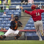 Binghamton Mets catcher Albert Cordero tags out Matt Skole of the Harrisburg Senators in the first inning of the B-Mets 2-1 loss to the Senators at NYSEG Stadium on Thursday evening.