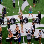 Some of the 300 MSU  Spartan Marching Band members find their places in East Lansing as the band practices for a performance earlier this fall.