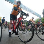 Bicyclists for the 35-mile Tour de Lou bicycle course start their journey on North Preston Street between River Road and Witherspoon Street. May 1, 2016