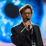 Johnny Depp seems distant in his role as a genius scientist type.