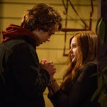 "Jamie Blackley, left, and Chloë Grace Moretz in a scene from ""If I Stay."""