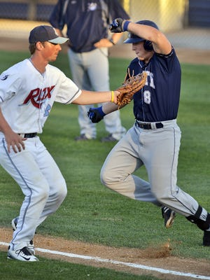 St. Cloud's Austin Athmann tags Duluth's TJ Martin out on the way to first base in a Northwoods League playoff game.