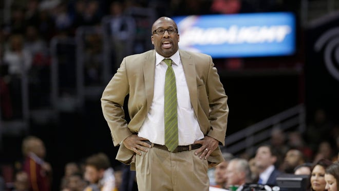 Cleveland Cavaliers head coach Mike Brown yells to his team during an NBA basketball game against the Houston Rockets Saturday, March 22, 2014, in Cleveland. (AP Photo/Tony Dejak)