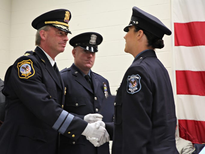 Clarkstown Police Chief Michael Sullivan congratulates graduate Clarkstown P.O.  Michelle Tierney as her husband, Clarkstown P.O. Robert Fortune, center,  looks on at the Rockland Police Academy graduation at the Rockland Fire Training Center  June 13, 2014.