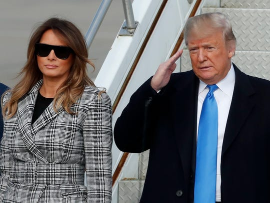 President Donald Trump, right, salutes as he departs Air Force One as he arrives with first lady Melania Trump on Tuesday, Oct. 30, 2018 in Coraopolis, Pa. The Trumps came to Pittsburgh honor the victims of the deadly shooting at a synagogue in Pittsburgh's Squirrel Hill neighborhood on Saturday. (AP Photo/Keith Srakocic) ORG XMIT: PAKS103