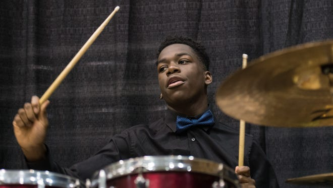 Rykeem Custis, 16, of Princess Anne, performs alongside members of the J. Jones Gospel Choir during the 30th Annual Youth Activity Celebration honoring Martin Luther King Jr. at the Wicomico Youth & Civic Center on Monday, Jan. 18, 2016.