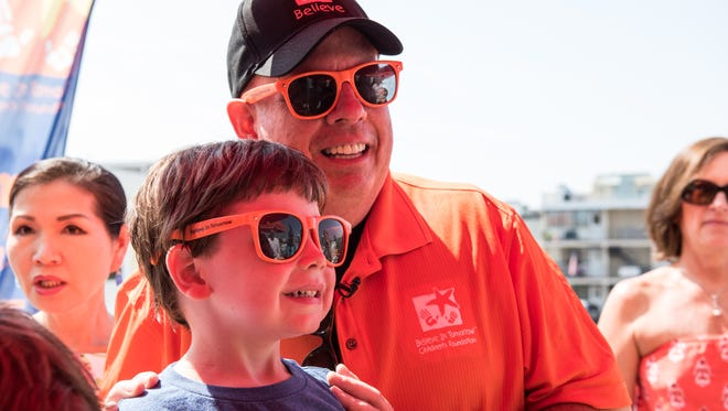Parker Biggs, 5, of Clarksburg, poses for a photo with Maryland Gov., Larry Hogan, during a visit to the Believe in Tomorrow House by the Sea on Friday, Aug. 19, 2016.  Biggs, who was diagnosed with Acute lymphoblastic leukemia as an infant, has spent three years in chemotherapy.