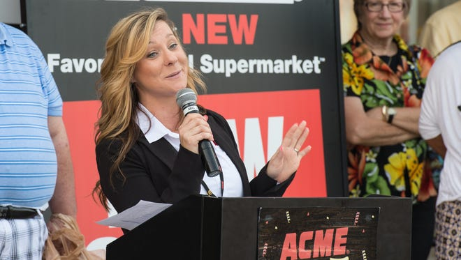 Renee Baldwin, ACME Salisbury store director, talks to an audience during the grand opening of the Salisbury location.