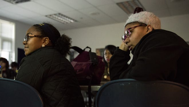 Pocomoke High School students, Manakai Johnson, 16, left, and Makia Boggs, 17, watch a live broadcast of the Inauguration of Donald J. Trump on Friday, Jan. 20, 2017.