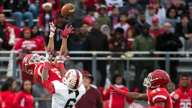 Paulsboro's Jacob Perez (5) intercepts a ball intended for Penns Grove's Joshua Martin (6) in a South Jersey Group 1 title game Saturday at Rowan University in Glassboro.