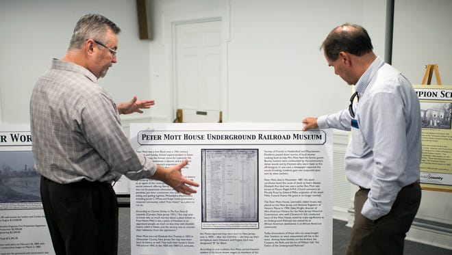 Executive director of the Camden County Historical Society Jack O'Byrne, left, and Jack Sworaski, director of division of Open Space & Farmland Preservation discuss the Peter Mott House Underground Railroad Museum historical sign during an unveiling Thursday, May 24, 2018 at the Camden County Historical Society in Camden, N.J.