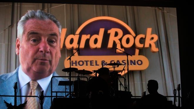 Hard Rock International Chairman & CEO Jim Allen is silhouetted as a video of him plays in the background during an opening ceremony at the Hard Rock Hotel & Casino Thursday, June 28, 2018 in Atlantic City. N.J.