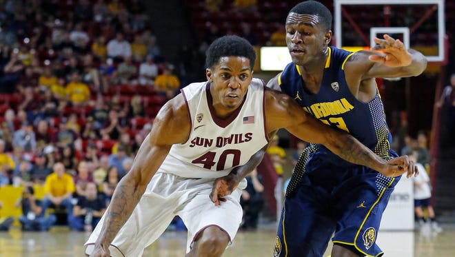 Arizona State Sun Devils guard Shaquielle McKissic drives to the net against California Golden Bears guard Jabari Bird during the first half of their NCAA basketball game Saturday, March 7, 2015 in Tempe, Ariz.