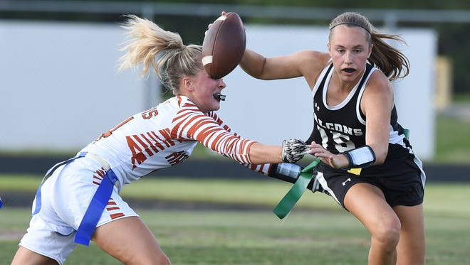 Jensen Beach's Jayci Grosso (15) gets past Harmony's Farah Lowe on Tuesday, May 16, 2017, during their high school flag football game at Jensen Beach High School.