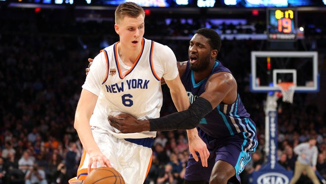 Knicks forward Kristaps Porzingis (6) driving against the Hornets' Roy Hibbert at Madison Square Garden on Friday night. Porzingis had 18 points to help lead the Knicks to the win.