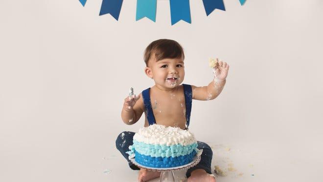 Eli, of Suntree, celebrates his 1st birthday. Eli is Space Coast Parent Magazine's August cover contest winner.
