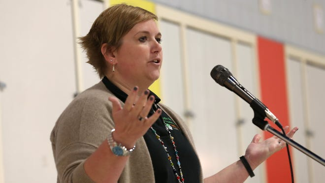 Emily Hamilton, executive director of the Des Moines I Have A Dream Foundation, speaks during the kickoff campaign of the 342 College Savings Plans for students at Findley Elementary School in October.