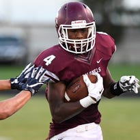 Henderson's Issac Anglin tries to avoid a tackle from Reitz's Jacob Pace as the Henderson County Colonels host the Reitz Panthers for the Hall of Fame game at Colonel Stadium Friday. The matchup is the first game of the season for both teams, August 19, 2016.