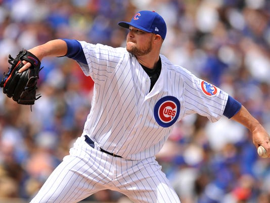 Chicago Cubs starting pitcher Jon Lester delivers a pitch during the first inning of a baseball game against the Pittsburgh Pirates Sunday, April 16, 2017, in Chicago. (AP Photo/Paul Beaty)
