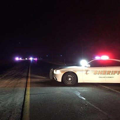 A sheriff's vehicle blocks westbound Iowa Highway 141