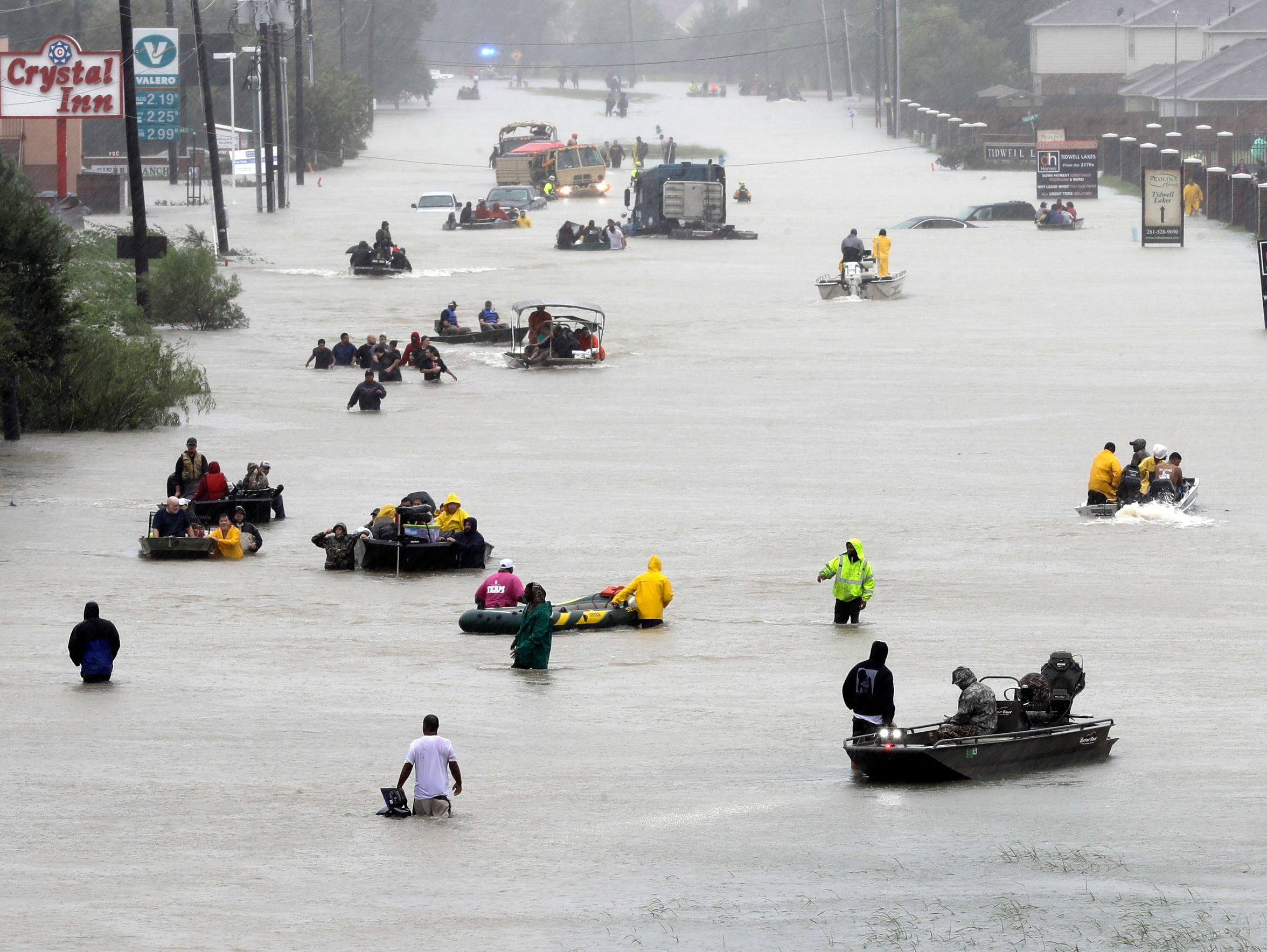 In this Aug. 28, 2017 file photo, rescuers help evacuate Houston residents from flooded areas inundated by Hurricane Harvey's rains. Corpus Christi was spared by the storm, but experts say without proper planning the city could face the same situation in the next.