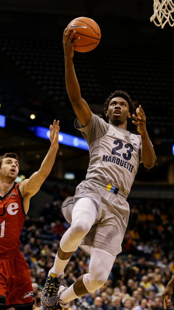 Marquette's Jajuan Johnson comes in for a layup past SIU-Edwardsvilles' Burak Eslik.