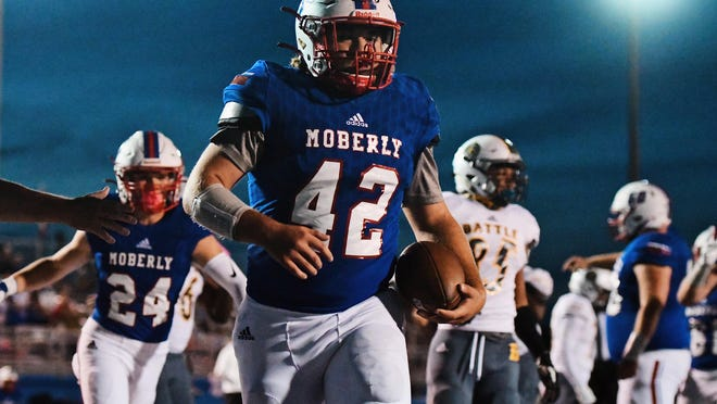 Moberly's Jarrett Kinder (42) carries the ball into the end zone during a game against Battle on Friday night at Moberly High School.