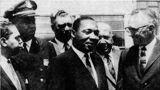 At the airport, the Rev. Dr. Martin Luther King, third from right, was greeted by, from left, James Del Rio, the Council for Human Rights; Detroit Police Lt. George Harge; Inspector Robert Harbour, Wayne County Sheriff's office; Benjamin McFall, director of the Human Rights group and Police Commissioner George Edwards on June 23, 1963.