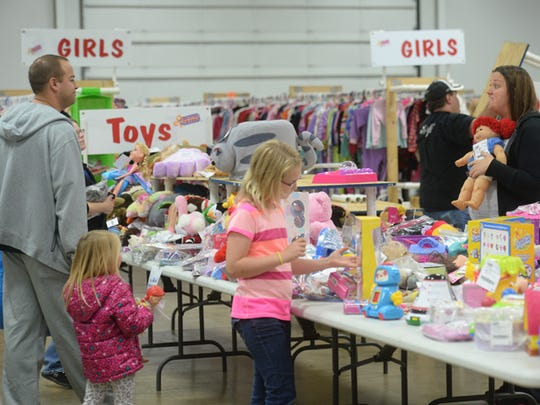 Shoppers look for deals during last year's Just Between Friends sale Saturday inside the Kuhlman Center in Richmond.