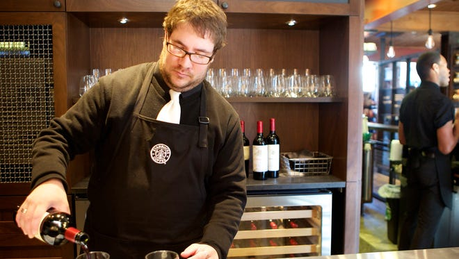 Barista Supervisor Casey O'Neill serves up wine at a Starbucks in Seattle.