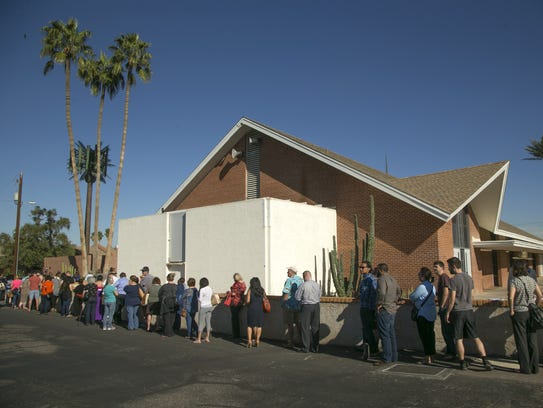 People wait in line to vote in Arizona's presidential