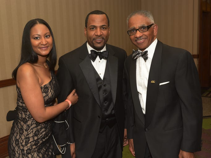 Tanya Gresham, Reggie Gresham, and Max Maxwell wait for the doors to open at the 100 Black Men Derby Gala.  May 1, 2014
