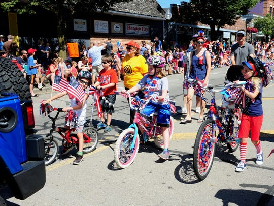 Members of North West Optimist Club take part in the annual Fourth of July Parade in downtown Milford.