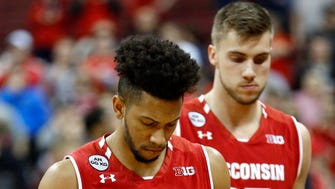 Wisconsin Badgers guard Jordan Hill (front) and forward Alex Illikainen show their disappointment adter losing to Ohio State on Thursday night.