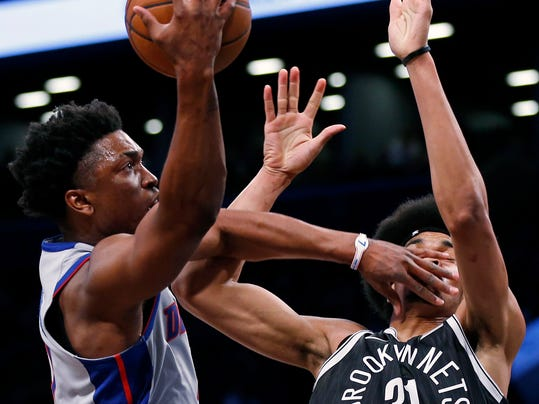 Detroit Pistons forward Stanley Johnson drives to the basket past Brooklyn Nets center Jarrett Allen (31) during the first half of an NBA basketball game Sunday, April 1, 2018, in New York. (AP Photo/Adam Hunger)