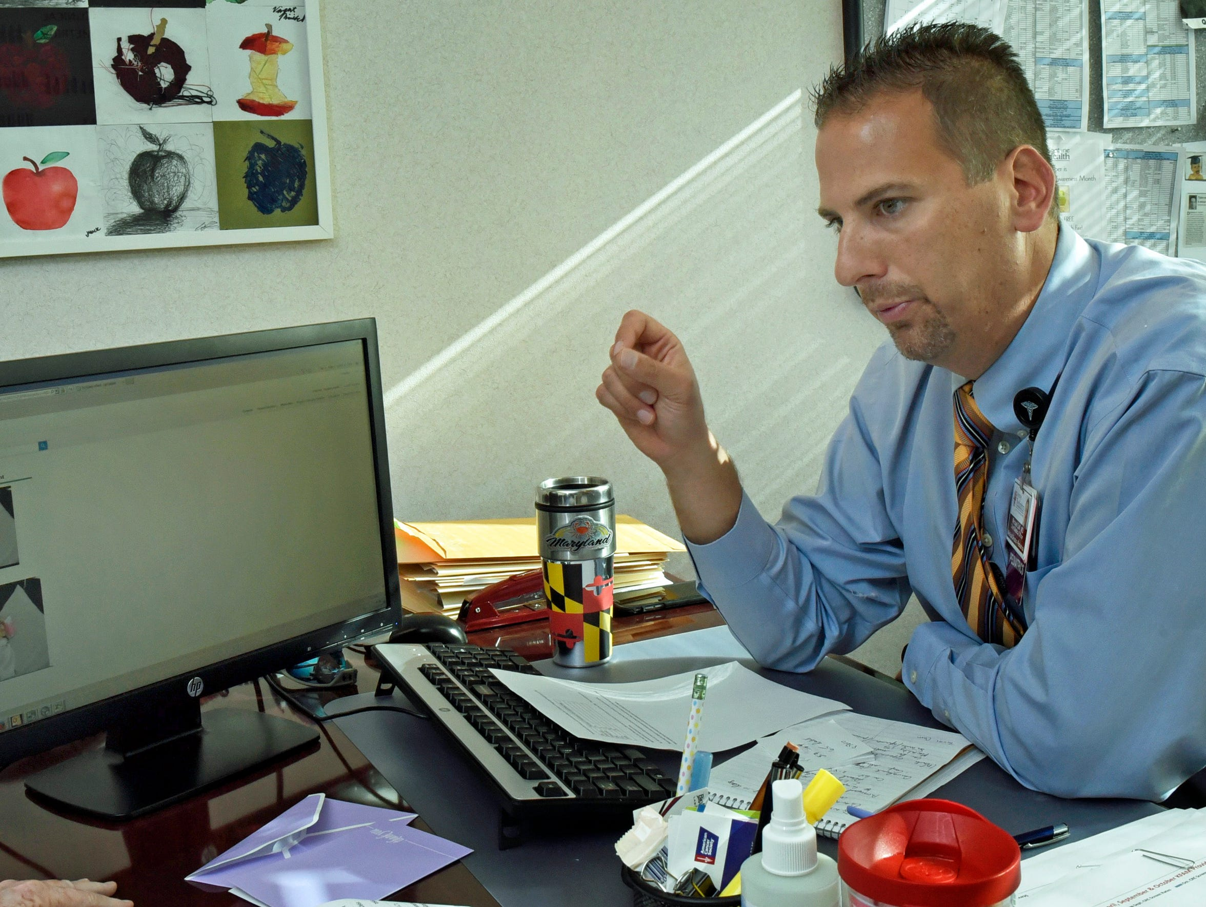 Dr. Michael Colli, pictured in his Chambesburg office