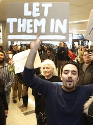 Supporters cheer as an Iranian citizen with a valid