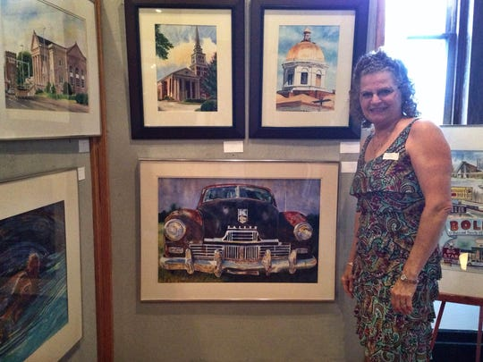 Mary Spellings displays her watercolor pieces at West Tennessee Hearing and Speech Center's fourth annual Speaking of Art fundraising event.