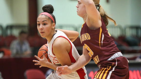 North Rockland's Lexi Huertas (4) drives to the basket