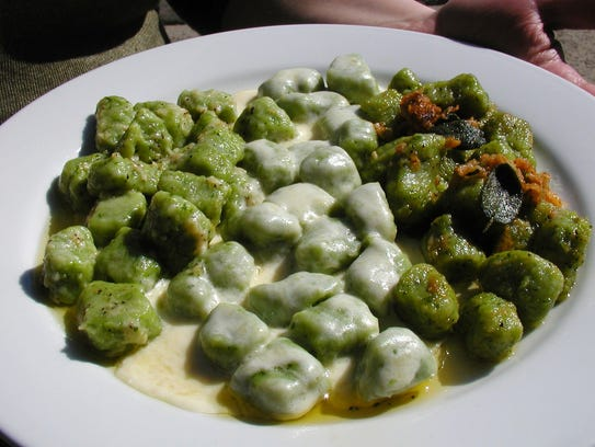 Spinach gnocchi, or dumplings are boiled and served
