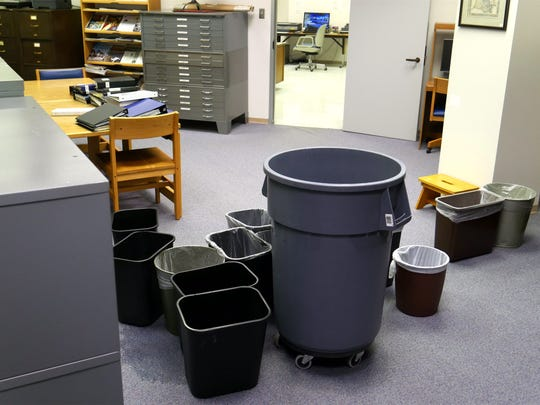 Trash bins collect dripping rain water at the LSU Archives